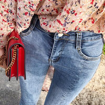 谜秀牛仔裤女2018春装新款韩版学生显瘦微喇chic不规则九分裤春潮