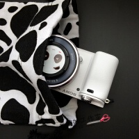 20180429052041490黑白奶牛帆布束口袋相机包 拍立得收纳整理 A6000内胆包 双层加绒