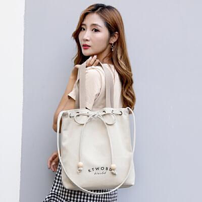 帆布包女2018新款抽绳水桶包购物袋原宿风手提单肩斜挎包