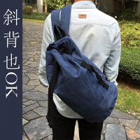 学生水桶包旅行男包韩版帆布抽绳双肩包两用单肩休闲圆筒背包书包 深蓝色