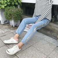 早春新款时尚百搭侧边彩绘高腰显瘦直筒小脚裤学生休闲牛仔裤女潮