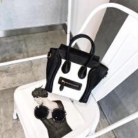 女士斜挎包时尚包包新款斜挎包女小包手提包单肩包撞色笑脸包 黑配白