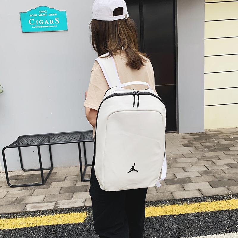 双肩包男校园学生书包女运动背包潮户外旅行包AJ乔丹时尚