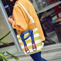 时尚条纹印花帆布包日韩新款手提撞色卡通多功能双肩女包